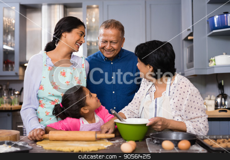 Portrait of multi-generation family standing together in domestic kitchen stock photo, Multi-generation family standing together in domestic kitchen at home by Wavebreak Media
