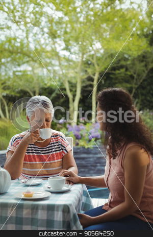Mother and daughter having tea stock photo, Mother and daughter having tea at home by Wavebreak Media