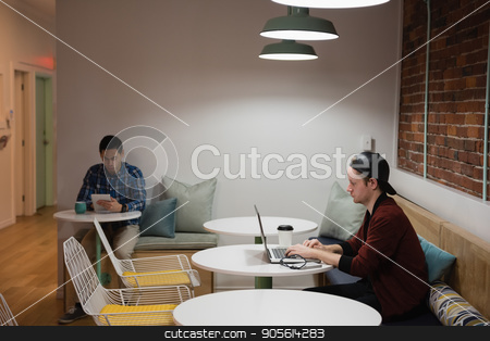 Executive using laptop in office stock photo, Attentive executive using laptop in office by Wavebreak Media
