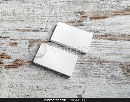 Stacks of business cards stock photo, Two stacks of blank business cards on vintage wooden table background. Mockup for ID. Template for branding identity. by Veresovich