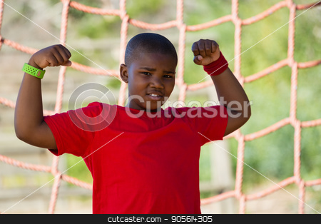 Boy standing in the boot camp during obstacle course training stock photo, Portrait of boy standing in the boot camp during obstacle course training by Wavebreak Media