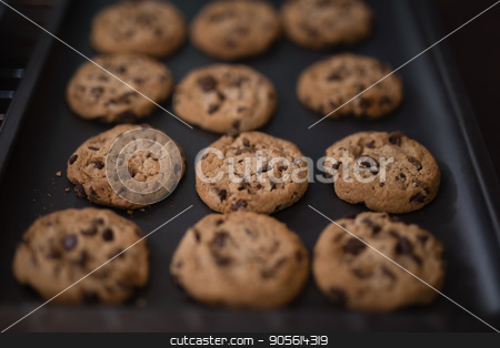 High angle view of baked cookies on black tray stock photo, High angle view of baked cookies on black tray at home by Wavebreak Media