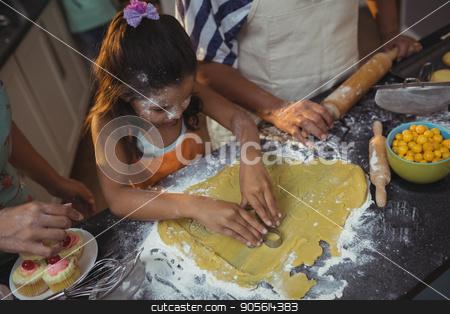 Family preparing dessert in kitchen stock photo, Family preparing dessert in kitchen at home by Wavebreak Media