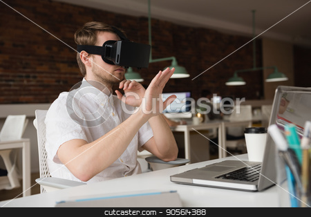 Male executive using virtual reality headset stock photo, Male executive using virtual reality headset in office by Wavebreak Media