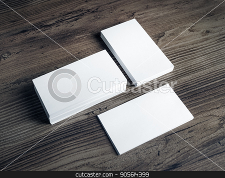 White business cards stock photo, Photo of blank white business cards on vintage wooden table background. Mock up for ID. Blank template for branding identity. by Veresovich