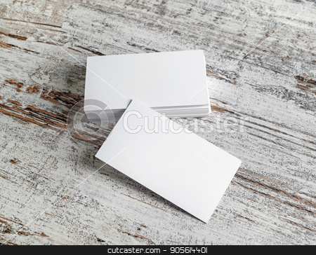 Empty business cards stock photo, Photo of empty blank business cards on wood table background. by Veresovich