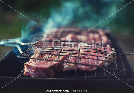 Grilling fresh entrecote pork stock photo, Grilling fresh entrecote pork on a grill by olinchuk