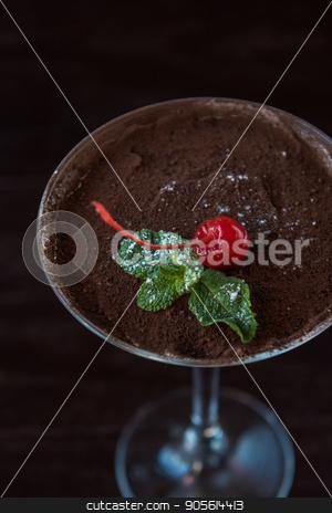 Ice cream chocolate dessert stock photo, Ice cream chocolate dessert decorated with cherry on dark brown background by olinchuk