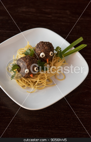 Funny meatballs with pasta stock photo, Funny meatballs with pasta greens and green onion for children menu by olinchuk