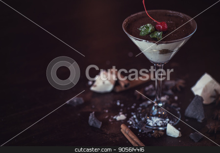 Ice cream chocolate dessert stock photo, Ice cream chocolate dessert decorated with cherry on dark brown background by olinchuk