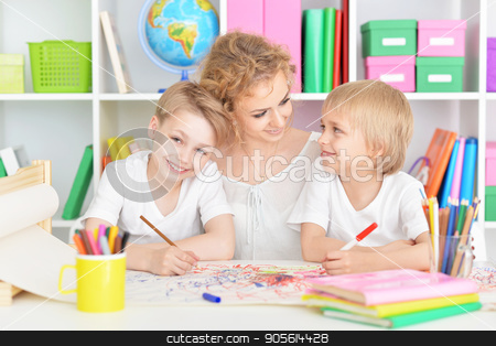 Mother drawing with cute sons stock photo, Portrait of happy mother drawing with three cute sons by Ruslan Huzau