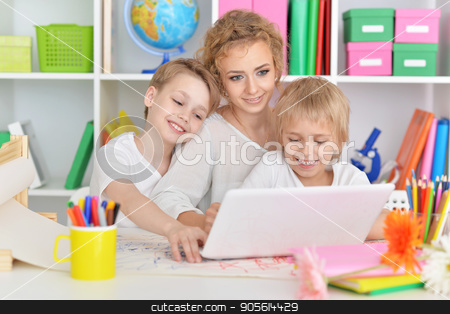 Mother drawing with three cute sons stock photo, Portrait of happy mother drawing with three cute sons by Ruslan Huzau