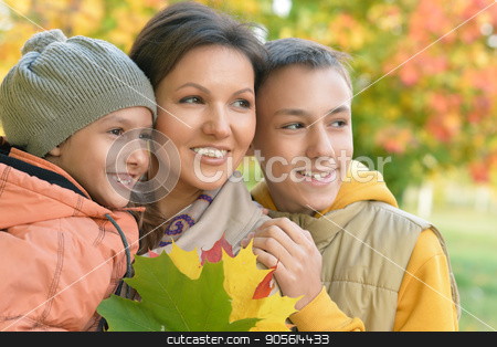Happy mother with children outdoors stock photo, Family portrait of happy mother with children outdoors by Ruslan Huzau