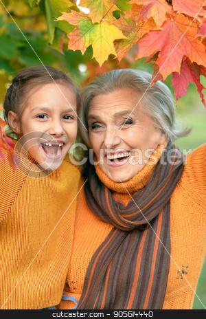 Grandmother and granddaughter having fun  stock photo, Portrait of a grandmother and granddaughter having fun outdoors by Ruslan Huzau