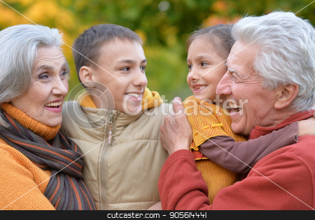 Grandparents and grandchildren outdoors stock photo, Family portrait of grandparents and grandchildren outdoors by Ruslan Huzau