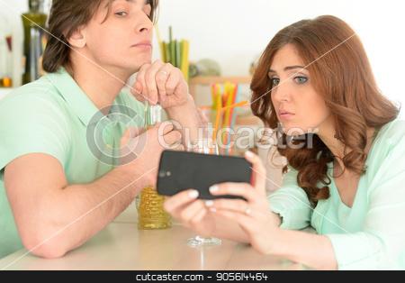 Young couple making selfie stock photo, Portrait of young couple making selfie with smartphone by Ruslan Huzau