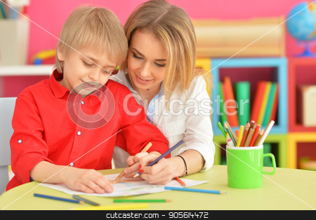 Mother with her son draw with pencils stock photo, Portrait of a mother with her son draw with pencils by Ruslan Huzau