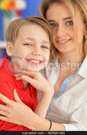 Smiling mother and son stock photo, Smiling mother and son looking at camera by Ruslan Huzau