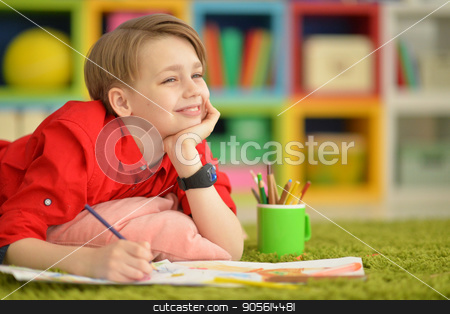 Cute boy drawing with pencils stock photo, Portrait of a cute boy drawing with pencils by Ruslan Huzau