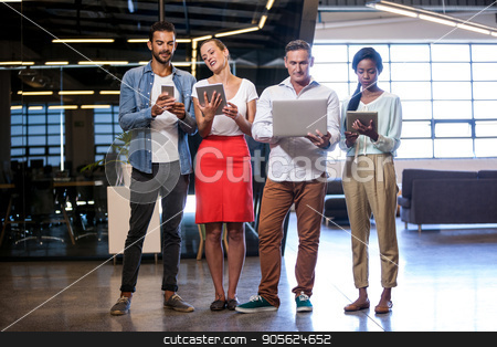 Confident business team standing stock photo, Confident business team standing in modern studio by Wavebreak Media