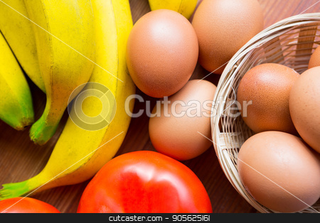 Close-up of fresh tomato, bananas and eggs stock photo, Close-up of fresh tomato, bananas and eggs in supermarket by Wavebreak Media