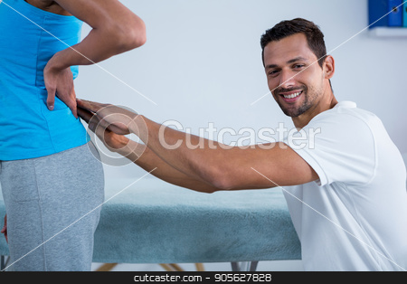 Physiotherapist examining womans back  stock photo, Physiotherapist examining womans back in clinic by Wavebreak Media