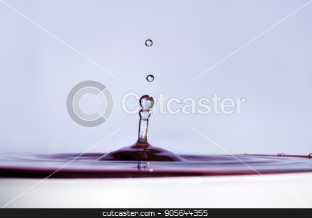 Water drop close up stock photo, Water drop falling into water and making droplet splash. Shallow depth of field. Selective focus. Lilac shade water. by Veresovich