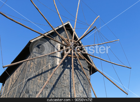 Old wooden windmill stock photo, Old wooden windmill in the background of the blue sky by Veresovich