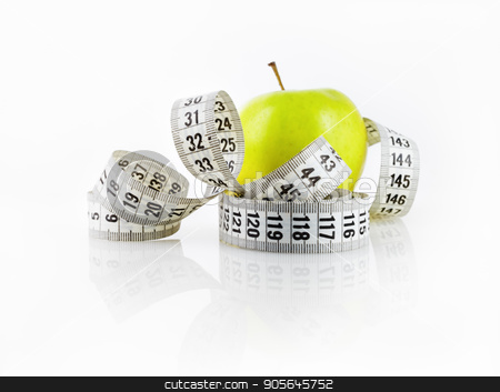 Apple and measuring tape stock photo, Fresh green apple and measuring tape. Symbol of diet and healthy lifestyle. Shallow depth of field. Focus on the measuring tape. by Veresovich