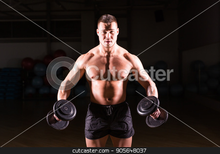 Muscular bodybuilder guy doing exercises with dumbbells. stock photo, Muscular bodybuilder guy doing exercises with dumbbells over black background by Satura86