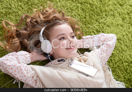 Cute little girl listening music stock photo, Cute little girl listening music with headphones by Ruslan Huzau