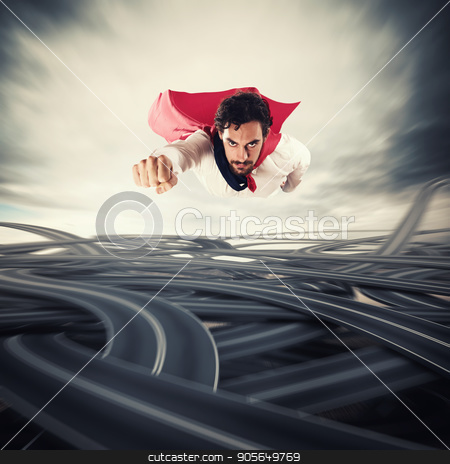 Overcome the difficulties. Concept of success and breakthrough stock photo, Male superhero with read cloak flying fast over road junctions. Concept of success and breakthrough by Federico Caputo