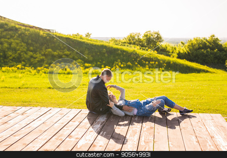 Happy family expecting baby stock photo, Happy family expecting baby. Pregnant woman outdoor by Satura86