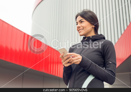Young woman active exercise workout on street outdoor stock photo, Young female active exercise workout on street outside using smartphone by Dmytro Sidelnikov