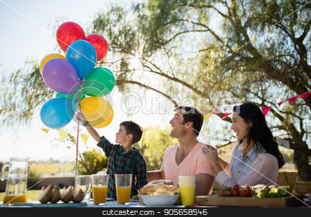 Family enjoying together in the park stock photo, Happy family enjoying together in the park on a sunny day by Wavebreak Media
