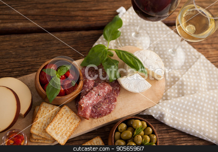 Overhead view of crackers with olives and meat by cheeses stock photo, Overhead view of crackers with olives and meat by cheeses on table by Wavebreak Media