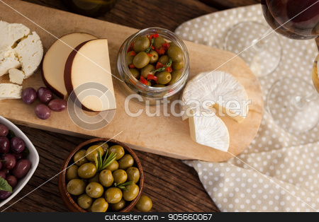 Olives with cheese and vegetable stock photo, High angle view of olives with cheese and vegetable on table  by Wavebreak Media