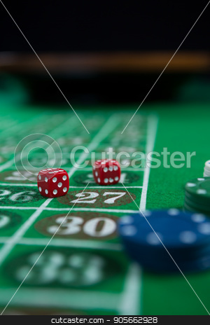 Close-up of dices and chips stock photo, Close-up of dices and chips on roulette table by Wavebreak Media