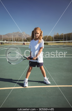 Portrait of girl playing tennis stock photo, Full length portrait of girl playing tennis on court during sunny day by Wavebreak Media