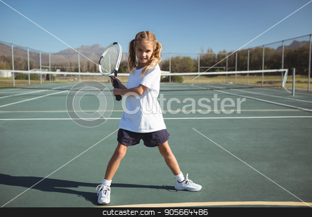 Full length of girl playing tennis stock photo, Full length of girl playing tennis on court during sunny day by Wavebreak Media