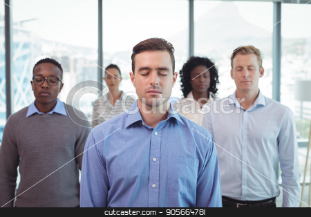 Business people with eyes closed at office stock photo, Business people with eyes closed standing at office by Wavebreak Media