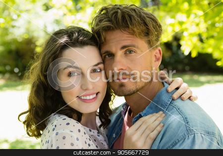 Couple embracing each other in garden stock photo, Close-up of couple embracing each other in garden by Wavebreak Media