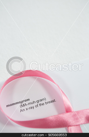 High angle view of pink Breast Cancer Awareness ribbon on paper with text stock photo, High angle view of pink Breast Cancer Awareness ribbon on paper with text over white background by Wavebreak Media