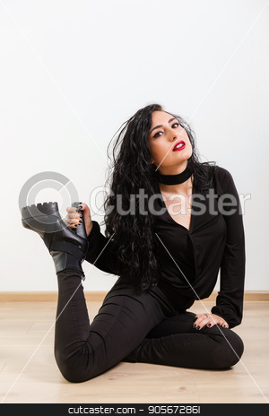 Girl in black jeans and black shirt, stands and poses in studio lighting white background stock photo, Girl in black jeans and black shirt, poses in studio lighting white background by LenaIvanova