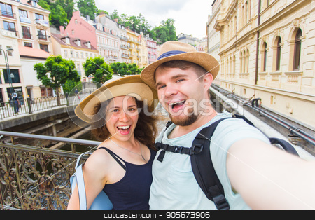 Happy couple, attractive woman and man walking in city and enjoying romance. Lovers making selfie and smiling. Tourists having fun together. Prague , Czech Republic stock photo, Happy couple, attractive woman and man walking in city and enjoying romance. Lovers making selfie and smiling. Tourists having fun together. Prague , Czech Republic. by Satura86