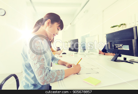 architect woman drawing on blueprint at office stock photo, business, startup and people concept - asian architect or creative female office worker with ruler and pencil drawing on blueprint by Syda Productions