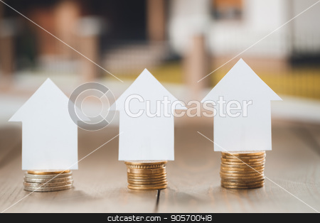 Real estate agency office objects isolated on table stock photo, Real estate agency office objects on wooden table no people by Dmytro Sidelnikov