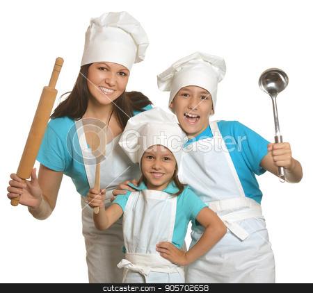 Mother and children in chefs uniform stock photo, Mother and children in chefs uniform with kitchen utensils by Ruslan Huzau