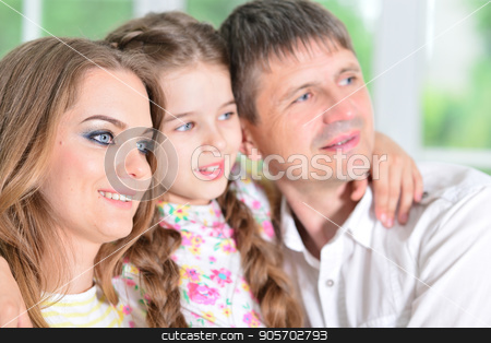 girl posing with  her parents stock photo, Close up portrait of cute little girl posing with  her parents by Ruslan Huzau