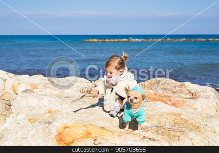 Child with little dog stock photo, Child with little dog playing outdoor in summer by Satura86